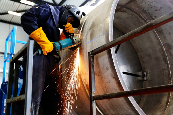 Grinding a weld with full PPE